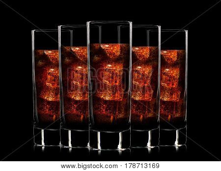 Set of colorful cocktail glasses with soft drinks on black background