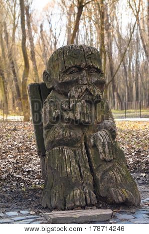 wooden sculptures grandfather art object natural park