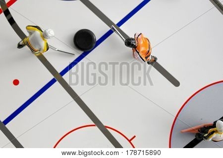 Toy hockey game with two players and puck from above