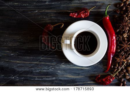 A Cup Of Coffee With Dried Chili And Other Ingredients. Useful Dietary Drink.
