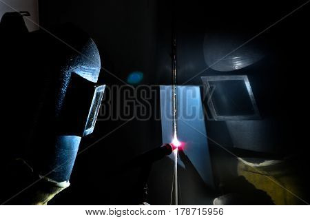 Argon welder uses torch to make sparks during manufacture of metal equipment