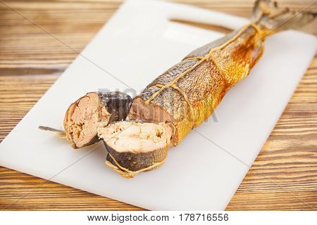 Hot Smoked Salmon Fish On Kitchen Board On Table