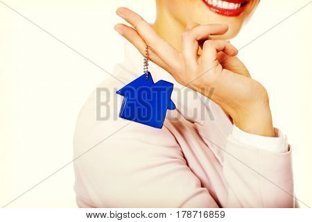 Business woman real estate agent with house pendant