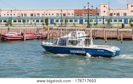 Venice Italy - September 28 2015 : Water channels of Venice city. Police boat patrol the water canals in Venice Italy.