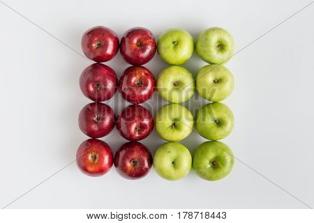 Top view of red and green apples in a row isolated on white background