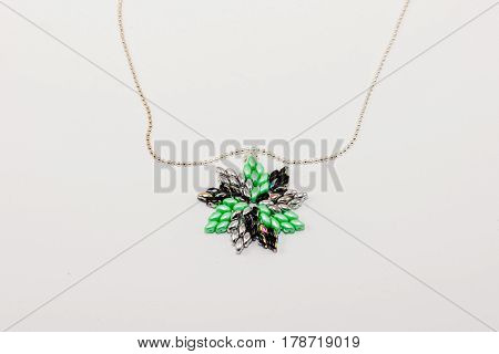 a custom made beaded green silver pendant