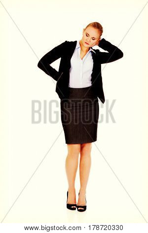 Business woman having huge neck pain