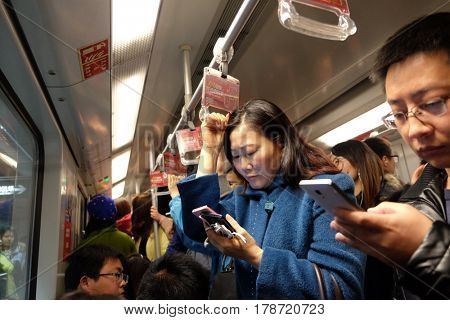 SHANGHAI - FEBRUARY 29, 2016. Packed train car, subway. 12 metro lines and 287 stations, with an operating route length of 439 KM, making Shanghai the third longest metro in the world. Shanghai.