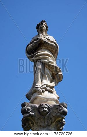 KRAPINA, CROATIA - APRIL 21: Statue of Virgin Mary on a column in front of the Church of St. Catherine of Alexandria in Krapina, Croatia on April 21, 2016.