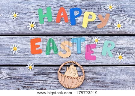 Happy Easter cutout letters. Festive greetings and plywood figurine. Easter holiday congratulations.