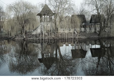 an old Cossack fortress in a Park landscape photo effect