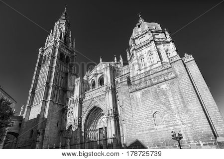 Toledo (Castilla-La Mancha Spain): facade of the medieval cathedral in gothic style. Black and white