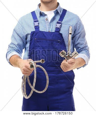 Plumber with flexible hose and tap on white background