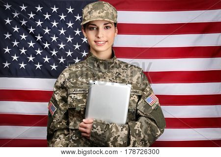 Female soldier with tablet on flag background