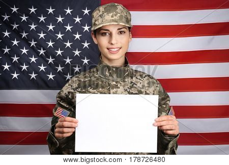 Female soldier with blank poster on flag background