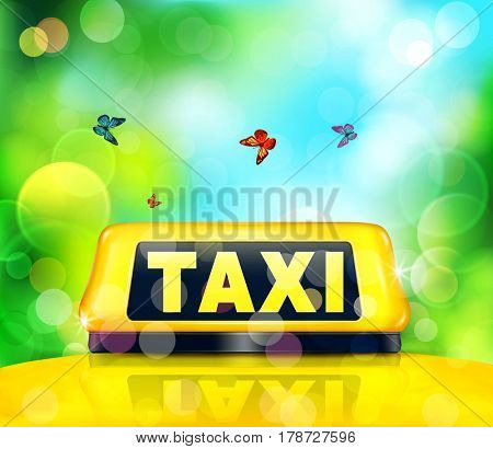 Yellow taxi sign on the car on a blue- green background