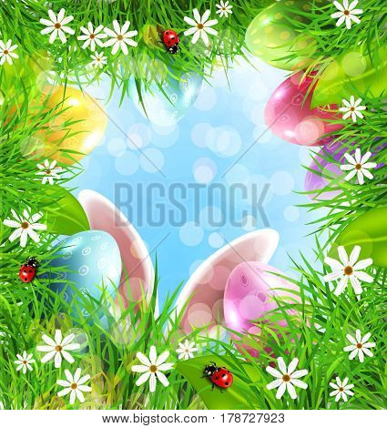 Easter background with rabbit ears, eggs, grass and blue sky.