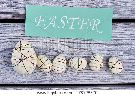 Easter card and styrofoam eggs. Easter eggs with colored ribbons. Decor from light material.