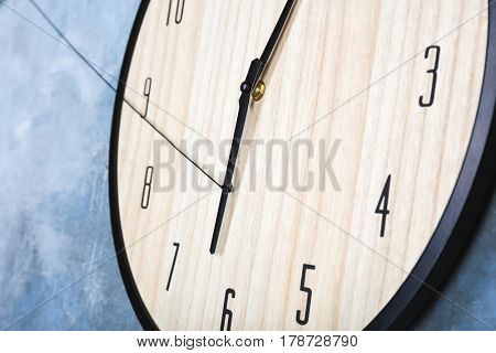 Big clock hanging on color wall