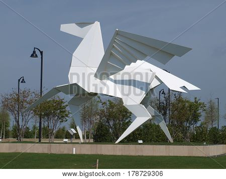 Dallas,USA,26th March 2017. The massive white Pegasus art piece curated by the development Cypress Waters, is a community crown jewel. This is the second major art the developer has displayed for the Metroplex.