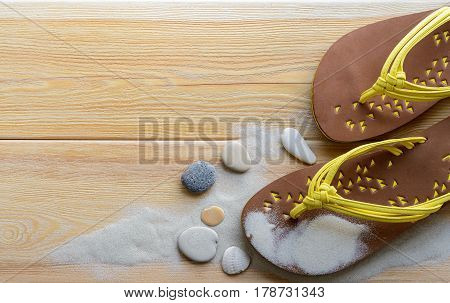 Summer vacations, beach slippers on wood deck. Beach holiday background