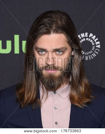 LOS ANGELES - MAR 17:  Tom Payne arrives for the PaleyFest 2017-The Walking Dead on March 17, 2017 in Hollywood, CA