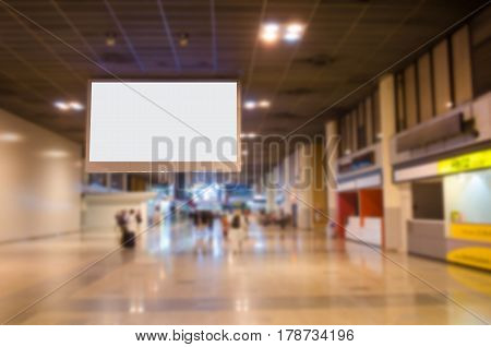 blank billboard with empty copy space in the airport for new advertisement with blurred interior airport background.