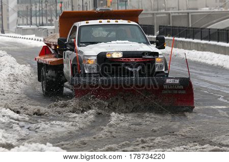 BRONX NEW YORK - MARCH 14: Sanitation truck plowing snow in the Bronx. Taken March 14 2017 in New York.