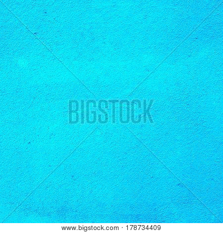 Background of a deep blue stucco coated and painted exterior, rough cast of cement and concrete wall texture, decorative coating