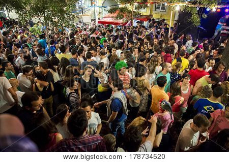 Lisbon Portugal - June 13 2014: People at a party (Arraial) in the Alfama neighbourhood during the Saint Anthony Feast in Lisbon Portugal
