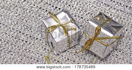 silver package gift with gold ribbon