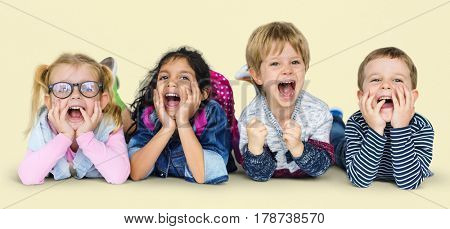 Little Children Laying Down Smiling Happy