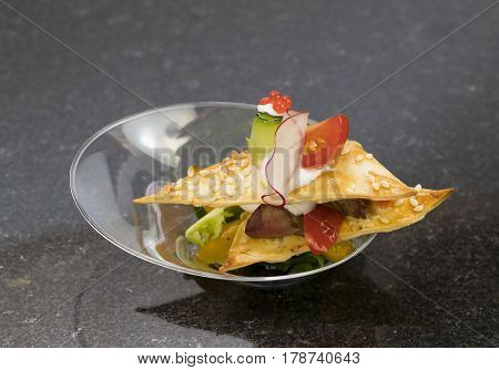 Mini canapes with elements of molecular cuisine on ston