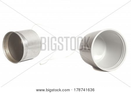 tin can phone on white . communication concept