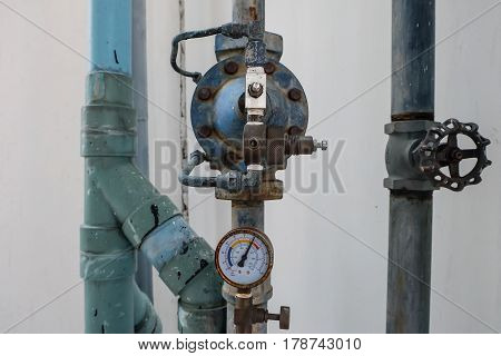 Manometer, Measuring Gas Pressure. Pipes And Valves At Industrial Plant.
