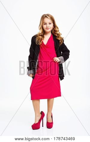 Beautiful girl in mother's pink midi dress, black jacket, pink shoes, isolated on white background