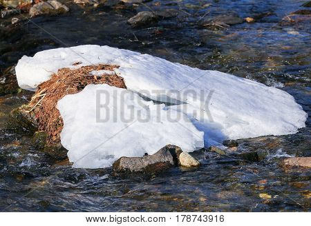 The Falschauer river in the Ulten Valley in South Tyrol with remains of snow and bubbling water.