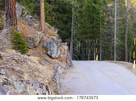 Narrow winding serpentine road in the mountains in the Ulten Valley in South Tyrol.