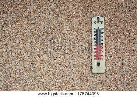 Thermometer On Brown Wall