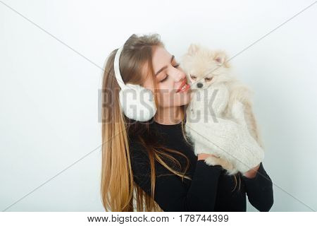Sexy Pretty Happy Girl With Small Pomeranian Dog In Earmuffs
