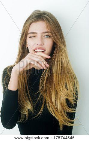 Flirting Pretty Girl With Long Hair Winking