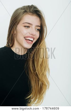 Happy Pretty Girl With Long Blond Hair In Black