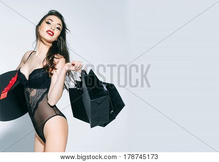 Sexy Woman With Red Lips In Bodysuit With Box, Package