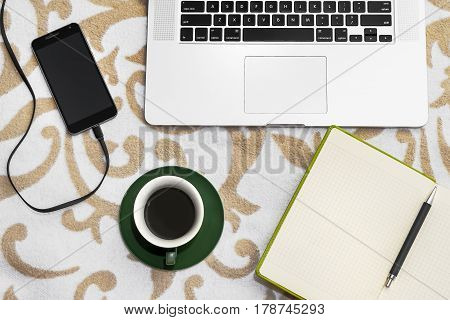 Business Ready Computer, Notebook And Pen With Cell Phone And Coffee On Sofa