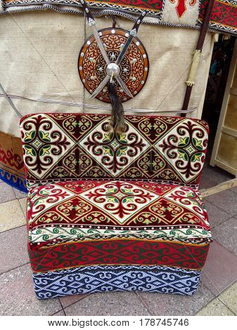 ALMATY KAZAKHSTAN - MARCH 26 2017: Kazakh ethnic sofa near yurt in Almaty Kazakhstan