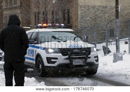 BRONX NEW YORK - MARCH 14: Police vehicle patrols community during snow storm. Taken March 14 2017 in New York.