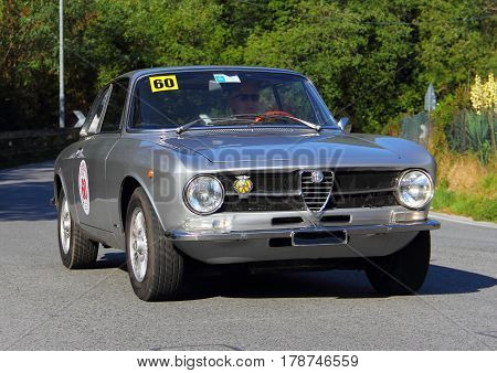 Mignanego Italy - September 25th 2015 - Reenactment 18th Pontedecimo Giovi: The Alfa Romeo GT 1967 conducted by Marco Capotosti during a timed regularity 'test.