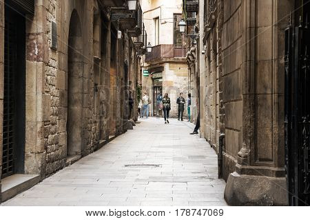 BARCELONA SPAIN - OCTOBER 22 2015: Narrow street in gothic quarter of Barcelona the capital city of the autonomous community of Catalonia in the Kingdom of Spain