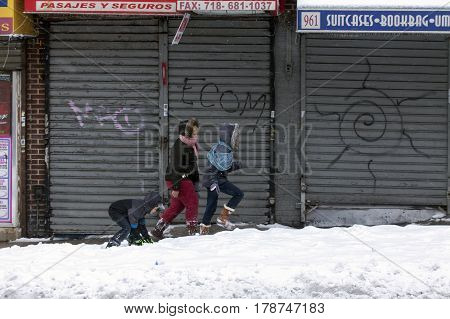 BRONX NEW YORK - MARCH 14: People walking in snow storm. Taken March 14 2017 in New York.