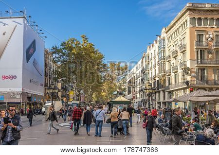 BARCELONA SPAIN - OCTOBER 22 2015: La Rambla is a pedestrian street in central Barcelona popular with tourists and locals alike Spain